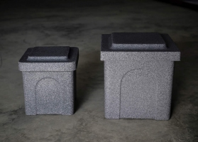 "Poly Urn Vaults are available in two sizes and two colours. Shown here are both sizes:  small 10 x 10 x 12"" and large 13 x 13 x 15"", both in grey granite."