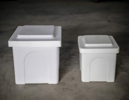 "Poly Urn Vaults are available in two sizes and two colours. Shown here are both sizes:  small 10 x 10 x 12"" and large 13 x 13 x 15"", both in white."