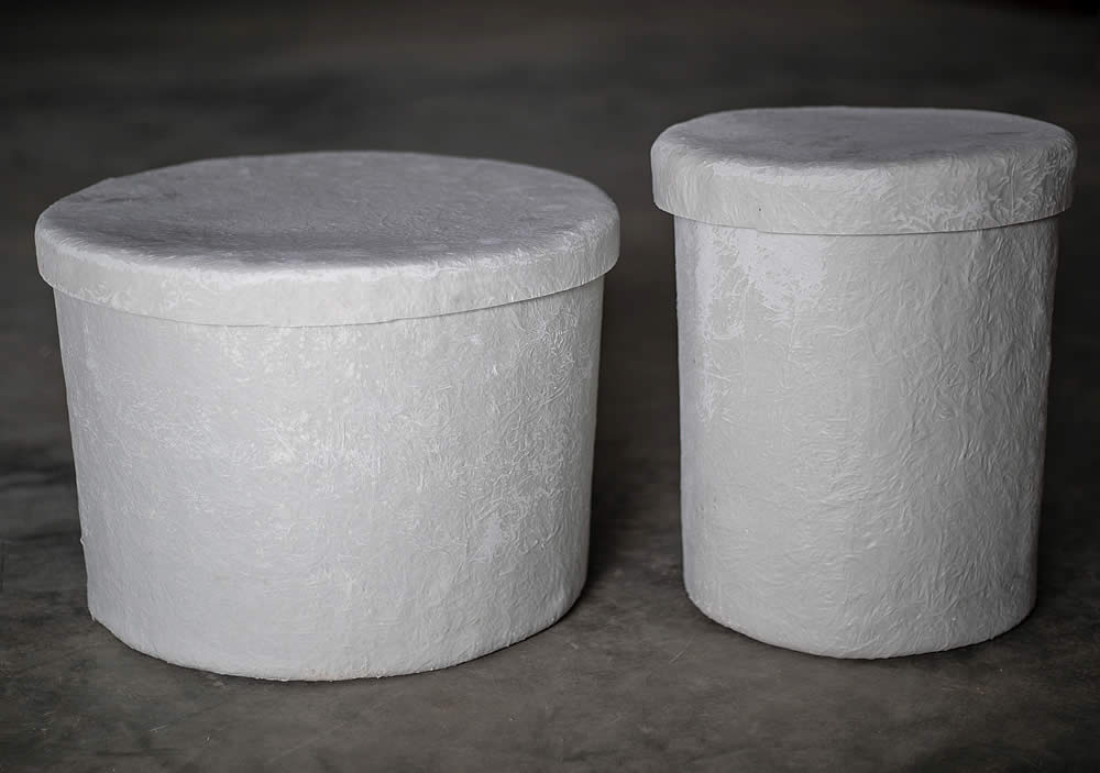 """Round Fiberglass Urn Vaults are available in two sizes. Shown here are the small vault: 11.5"""" OD x 14.5"""" deep, and the large vault: : 17.5"""" OD x 12.5"""" deep."""